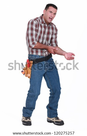 builder with pain in arm - stock photo