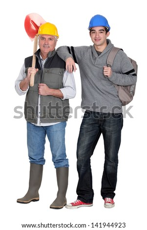 Builder with young apprentice - stock photo