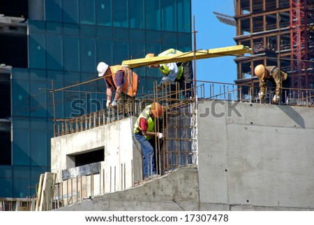 Skyscraper Construction Workers on Skyscraper Construction