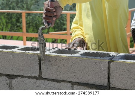 Building a cement block wall for a house - stock photo