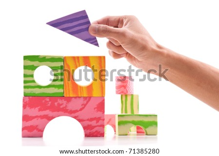 Building a Foam Block Building - stock photo