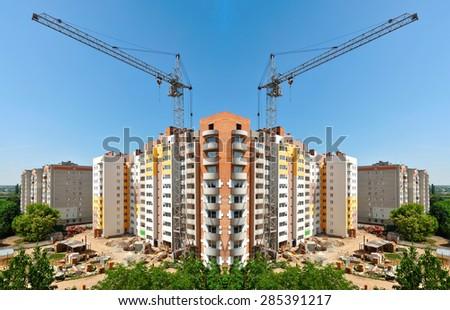 building a new block of flats panorama - stock photo