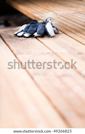 Building a patio with wooden terrace and stones - stock photo