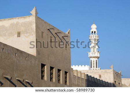 Building and minaret in Manama city, Bahrein - stock photo