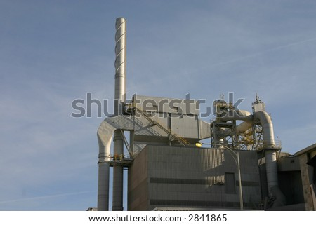 building and stack at oil refinery - stock photo