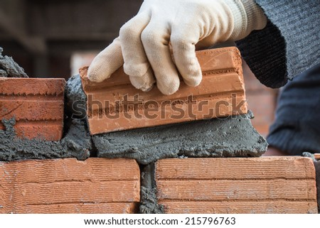 Building brick block wall on construction plant - stock photo