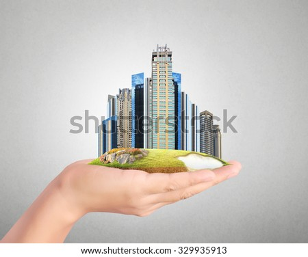 building city center on hand - stock photo