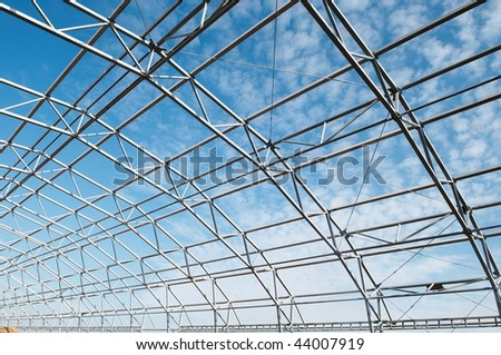 building construction of metal steel framework outdoors - stock photo