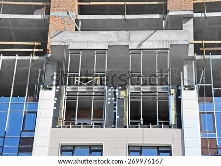Building construction site from concrete and brick - stock photo