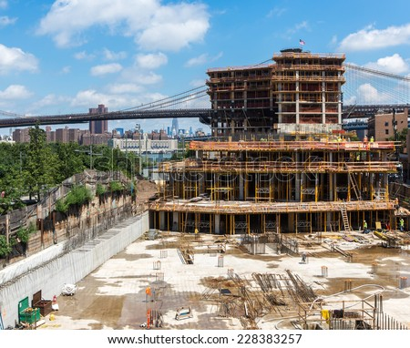Building construction site near Brooklyn Bridge, NY city - stock photo