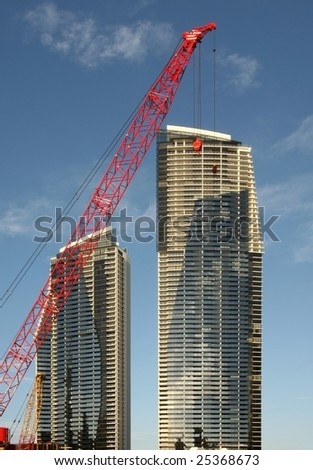 Building construction with red crane - stock photo