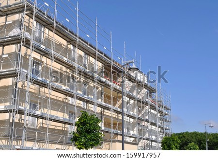 building construction with scaffolding in the city - stock photo