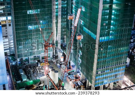 Building construction with tower cranes looking from above - stock photo