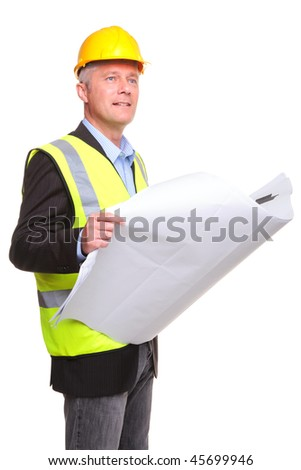 Building contractor wearing safety clothing holding some blueprints, isolated on a white background. - stock photo