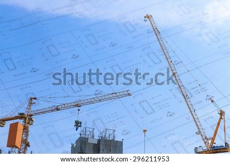 Building crane and construction site under blue sky  - stock photo