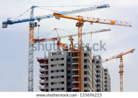Building cranes and building house.israel.tel aviv - stock photo