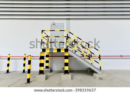 Building Emergency Exit with Exit Sign and Fire Extinguisher. - stock photo