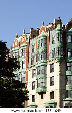 Building exterior of Boston Back Bay mansion. Verdigris, copper bay windows - stock photo