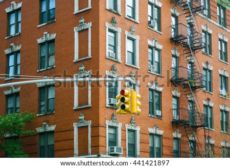 Building facade and traffic light in New York City, USA - stock photo