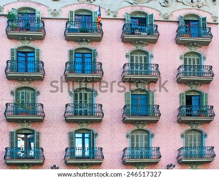 Building facade with antique balconies  - stock photo