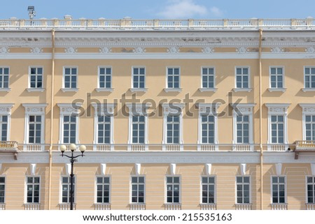 building front wall with repeting pattern of windows. st. petersburg, russia - stock photo