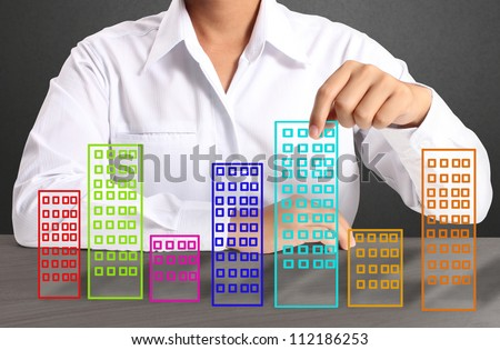 Building in hand businessmen - stock photo