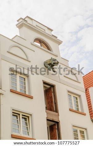 Building in historic Wismar, a Hanseatic League town in Northern Germany on the Baltic Sea, with elegant building styles from 14th-century Gothic to 19th-century Romanesque revival. - stock photo