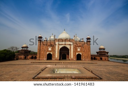 building in side of the taj mahal with blue sky - stock photo