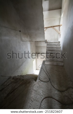 Building inside under construction ,stair hall - stock photo