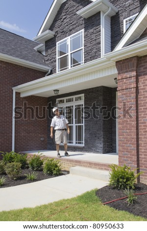 Building inspector checking block walls, building framing,electrical and plumbing stub outs - stock photo