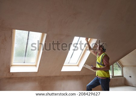 Building Inspector Looking At New Property - stock photo