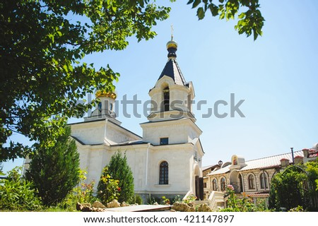 building of church and green yard - stock photo