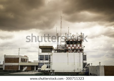 Building of Flight control tower with clouds - stock photo
