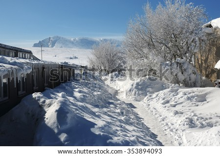 Building of meteorological station on the snow-covered plateau,  - stock photo