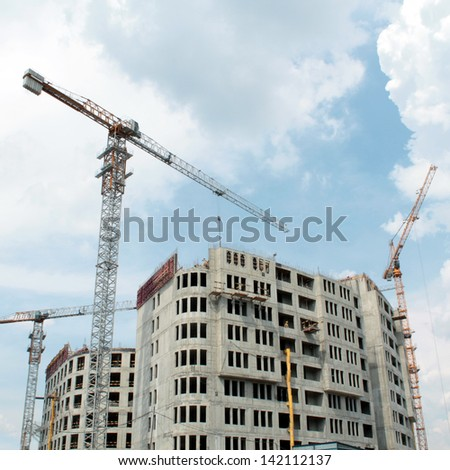 Building of new multi-storey house - stock photo