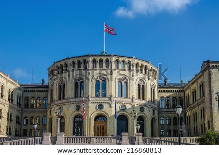 Building of Norwegian parliament (Stortinget) with flag of Norway, Oslo - stock photo