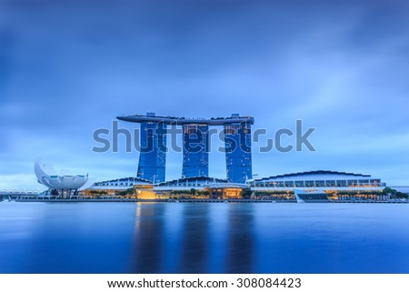Building of Singapore city at night - stock photo