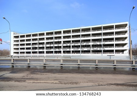 Building peoples garages on the background of the road and the blue sky. - stock photo