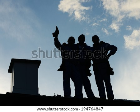 Building roof construction site teamwork - stock photo