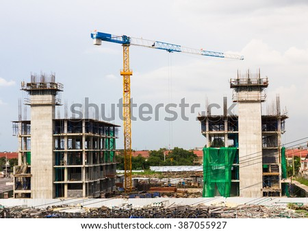 Building site and Construction cranes in construction site - stock photo