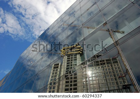 Building Site mirrored by Glass Facade - stock photo