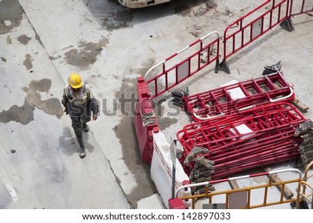 Building site with construction worker - stock photo