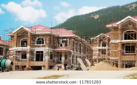 Building site with new homes under construction - stock photo