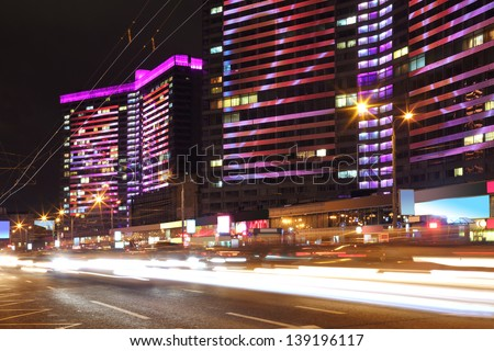 Building with bright multi-colored illumination on New Arbat street at night in Moscow, Russia. - stock photo