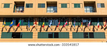 Building with flags of different countries close up - stock photo