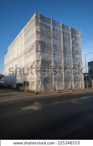 Building with scaffolding all over - stock photo