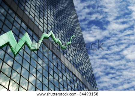 building with stock chart - stock photo