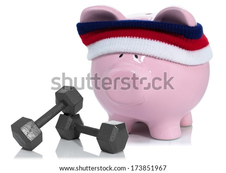 Building your savings, piggy bank working out - stock photo