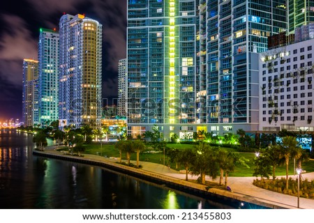 Buildings along the Miami River at night, in downtown Miami, Florida. - stock photo