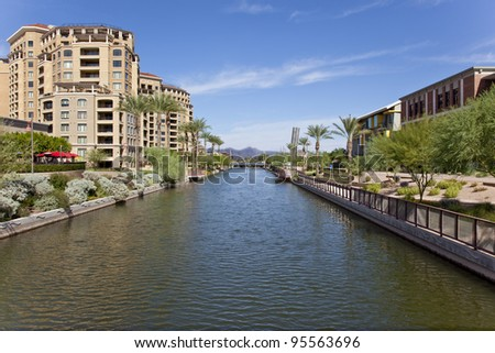 Buildings along the Salt River Project canal in Scottsdale Arizona's waterfront district. - stock photo